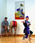 Okinawan dancer throws a karate punch to the accompaniment of drums at the Japanese Cultural Day in Cupertino, CA