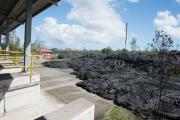 The 2014 Kilauea lava flow stops just a few feet from the transfer station in Pahoa, Hawaii.