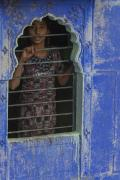 Young Girl Looking Thru Her Window