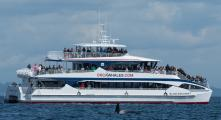 Guests abord the Island Explorer 5 viewing an Orca on an Orca watching trip in the San Juan Islands, Washington