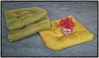Flower Vase Resting with Colored Pillows