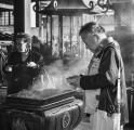 Man Preparing Incense Offering At Temple On New Year's Day, Kyoto