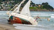 A sailboat run aground at Pacifica State Beach attracts the curious, April 29, 2018