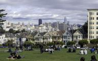 Iconic San Francisco Views from Alamo Square Park. Old and new-Victorian Homes from the 1890's and 2018 skyline with Transamerica Pyramid, Bank of America Building and new Salesforce Tower