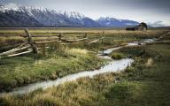 Fence, Ditch and Grand Tetons